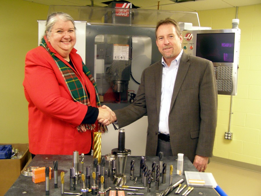 Dr. Gail Carberry, President of QCC (l) and Mr. Bob Hellinger, President of Emuge Corp (r) with a sampling of Emuge Tools in foreground.